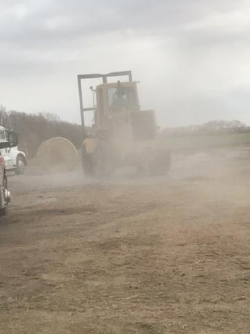 Unloading bales