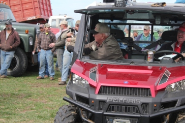 Bud watching his equipment he spent years gathering being sold at his auction.